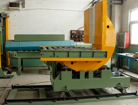 upender/tilter with track and conveyor
