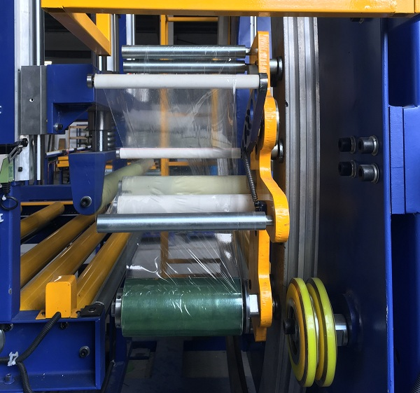 orbital wrapper film carriage for tension control