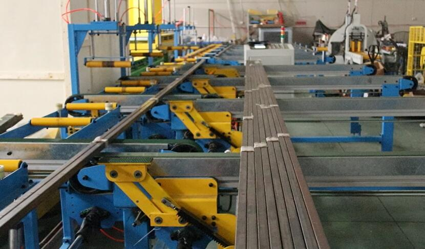 Aluminum sub-bundle transfer conveyor