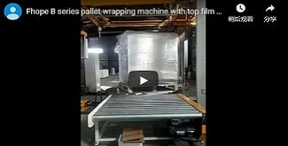 Automatic pallet packing line with top film dispenser