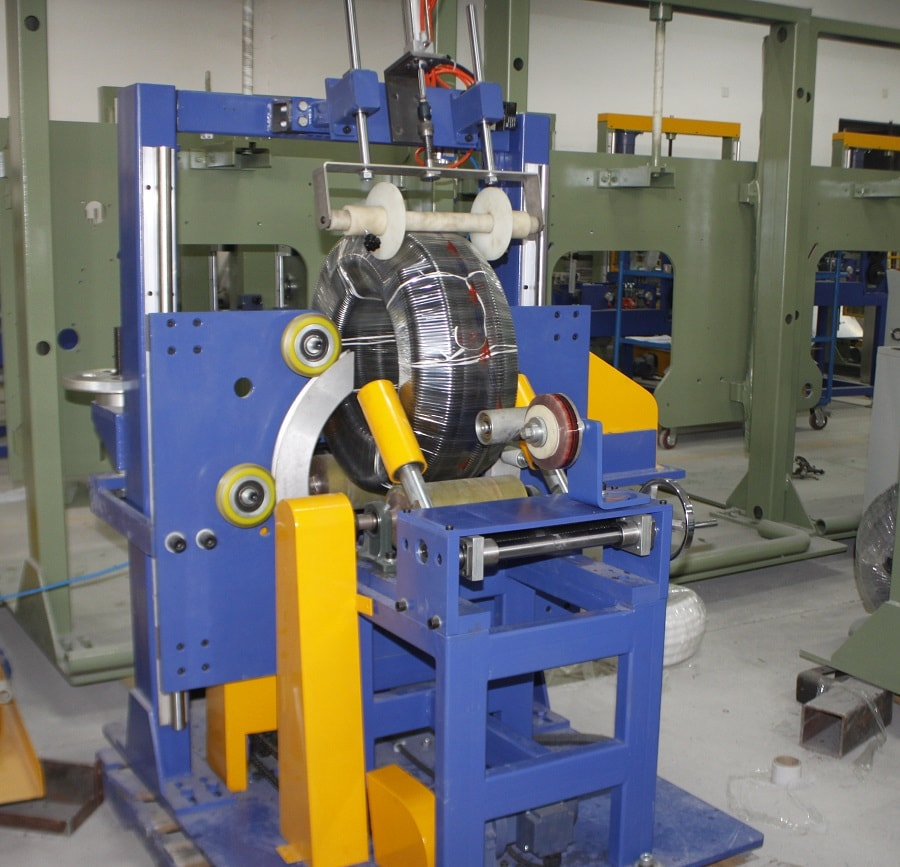 Corrugated hose stretch wrapping machine