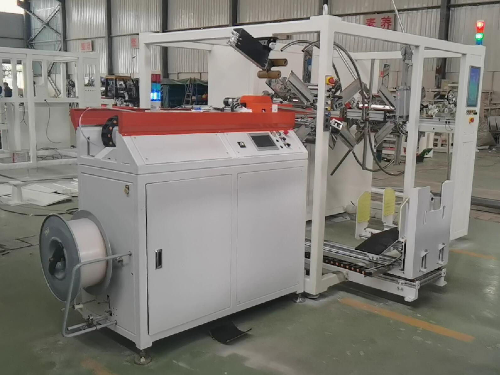 Automatic pipe coiling and strapping machine